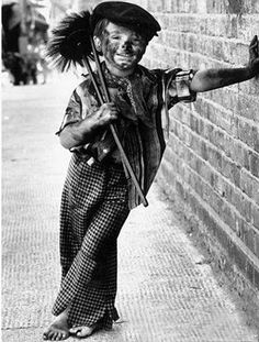Chimney sweep, before child labor laws outlawed the work of such young children His little bare feet :(