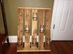 pallet with mason jar candle or flower holders