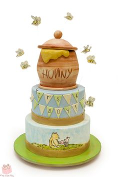This Cute Winnie The Pooh Baby Cake was made by Pink Cake Box. The top layer of the cake is Pooh's brown Hunny pot with Hunny overflowing out of it. Bees are flying around the Hunny Pot. The middle layer of the cake is light blue with a banner that. Baby Cakes, Baby Shower Cakes, Baby Shower Themes, Baby Boy Shower, Baby Shower Parties, Cupcake Cakes, Bee Cupcakes, Shower Ideas, Baby Showers