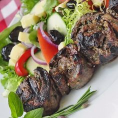 Herb and Garlic Rolled Steak Medallions - get your grill on with these tender, juicy rolled steak medallions infused with the flavors of favorite herbs and aromatic garlic; a versatile and easily adaptable grilling idea.