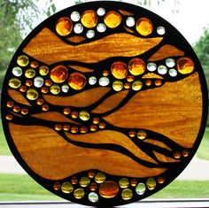 Glass and nuggets by SingularArt...has a mosaic look to it, but is actually copper foil Stained Glass technique - very cool!