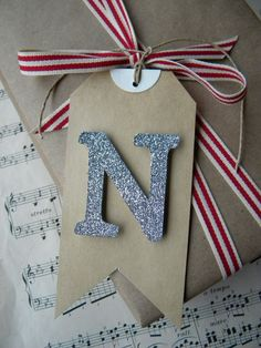 find this red/white ribbon. use with wood letters that we glitter ourselves for stockings!