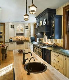 Transitional (Eclectic) Kitchen by Barbara Eberlein-love the faucets,range,dark blue cabinetry