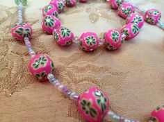 A close up of these bold fuchsia fimo beads