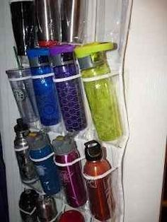 Keep water bottles and travel mugs from falling out of your cabinets.