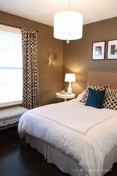 Paint Color: Mocha Latte by Behr Ultra. Love the trellis drapes and pillows from Z Gallerie. Chandelier from Overstock.