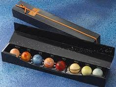 Artisan chocolates shaped like the planets...!  http://cafemereb.com/wp-content/uploads/2012/06/Chocolate-Planet-from-Osaka.jpg