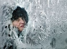 A woman looks out a bus in Bucharest on February 2, 2012