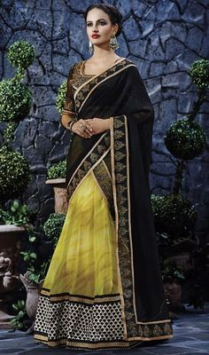 Unfold the aura of freshness with this black and yellow color georgette lehenga sari showing a effect of sensuality. The ethnic lace, resham and stones work with saree adds a sign of splendor statement for the look. #buttaworklehengasari #blackandyellowlehengasaris #partywearlehangasaree