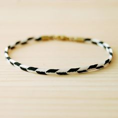 B&W Lariat Layering Bracelet from sonofasailor, $13..you can wear B&W bracelets with so many things!