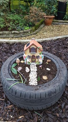 Fairy garden made from old tyre and pebbles collected from the beach