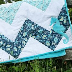 The cute little seahorse applique really steps up the popular chevron quilt design.  Mckay Manor Musers maritime quilt pattern (professionally printed $9.00, downloadable PDF $6.00)