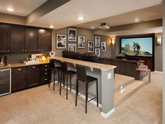 Basement media room with kitchenette.