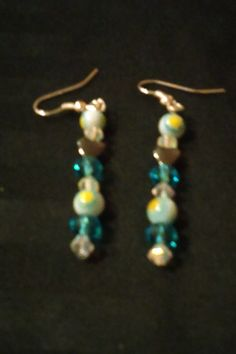 Check out this item in my Etsy shop https://www.etsy.com/listing/454700254/sunshine-baby-blue-drop-earrings