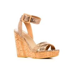 STUART WEITZMAN THE ANNEX WEDGE $398 Cracked metallic leather adds edge to the classic summer wedge. Team with pastels and prints for a resort-ready ensemble.  Adjustable ankle strap Heel measures approximately 4 ¼ inches with a 1 inch platform Available in chrome or penny cracked kid Leather insole Cork sole Made in Spain