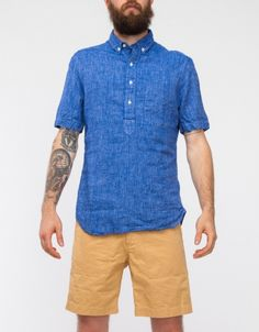 Short sleeve chambray and linen blend popover shirt from Gitman Bros. Features buttoned collar points, front chest pocket, and curved hemline.   80% Cotton, 20% Linen Made in USA