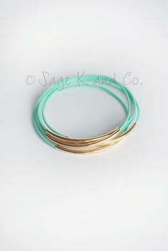 Mint Leather And Gold Tube Bangle Bracelet- Mint, Yellow, Turquoise, Gray, Pink, White and Black. $14.00, via Etsy.