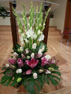 Floral arrangement using Monstera leaf - tropical, centerpieces, gladiolus
