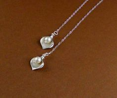 This gorgeous necklace is 18 long. A matte finished white gold plated adorable calla leaf is decorated with swarovski white pearls charm. Necklace is finished with sterling silver chain. Necklace is worn like scarf! I have matching earrings with that