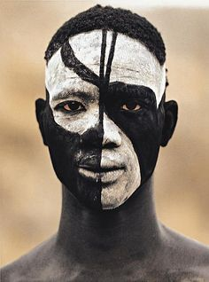 Africa | A Nuba from Kau with his painted face mask. Sudan. ca. early to mid 1970s. | © Leni Riefenstahl.