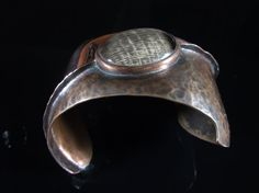 Single fold formed petrified palm wood copper cuff.