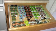 Clever! Organizer coffee pods in a drawer using a tension rod to keep them from sliding around the drawer.