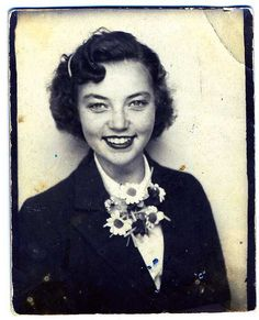 Young woman with a great smile and a daisy corsage. #vintage #photobooth