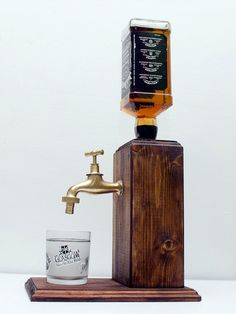 Handmade Wooden Whiskey Dispenser, Liquor Dispenser, Alcohol Dispenser, whiskey gift, liquor gift, alcohol gift - Free shipping worldwide **LIMITED TIME NEW YEARS 10% OFF ALL PRODUCTS** USE COUPON: TEN2017 Hand made alcohol dispenser with a brass tap. Fits regular sized bottles mainly up to 1 liter. The dispenser system is built into a large solid block of wood. The wood is hand stained and painted with pure tung oil for an alcohol resistant finish. Our system is easy to use, just turn th...