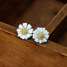 These elegant, daisy stud earrings are a must-have for every collection. Feel like a graceful fairy with this colorful pair, get on with your day with people admiring the realistic flowers in your ear
