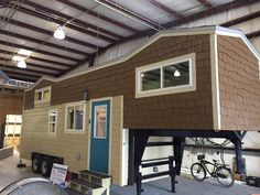 This is a 32′ Gooseneck Westbury model by Cornerstone Tiny Homes in Florida. I love the mix and match shingles and clapboards on the outside of the home, but the inside is where the magic is!…