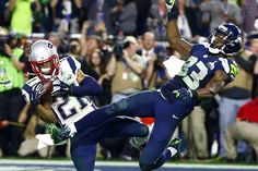 Week of Jan 31 - Feb 6, 2015 New England Patriots strong safety Malcolm Butler, left, intercepts a pass intended for Seattle Seahawks wide receiver Ricardo Lockette, right, in the fourth quarter of Super Bowl XLIX in Glendale, Ariz., on Sunday. The Patriots won the game 28-24. MARK J. REBILAS/USA TODAY SPORTS/REUTERS