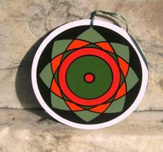 http://www.briansylvesterart.com/product/red-star-original-wood-ornament/#foobox-0/0/IMG_2784.jpg