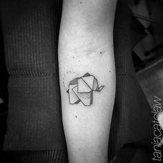 Origami elephant tattoo.