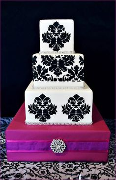 black, white and purple wedding cake <3...maybe turquoise flowers for mine