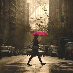 Simply strolling with a bright pink umbrella