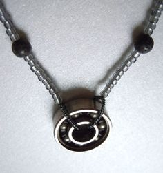 Roller Derby Skate Bearing Necklace With Lava and Czech Glass -Free Shipping-    http://www.etsy.com/listing/92734011/roller-derby-skate-bearing-necklace-with?ref=pr_shop