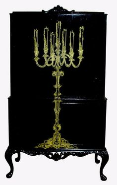 From Jimmie Martin, this Candelabra painted black armoire... Nice !