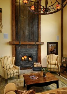 River Rim Ranch farm house...love the fireplace stove surround and distressed wood