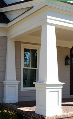 I love the horizontal/roof line trim work on this! The columns aren't my cup of tea.