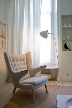 PP Mobler - Teddy bear chair and Serge Mouille floor lamp in white.