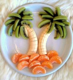 Beautiful arrangement of fruit. You will need oranges bananas and Kiwis. Peel off Skin Arrange oranges at the bottom into shape of mainland. Use bananas to create the steam of the palm tree. Take the Kiwis and stand them up. To resemble the palm tree. -Kacey