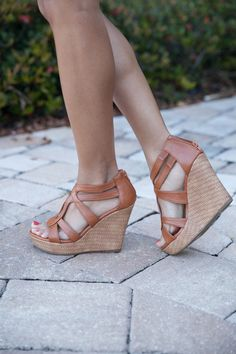 Our Laura Wedges are so effortlessly gorgeous - they are sure to complement your favorite dresses and jeggings! Cognac faux leather material, open toe, and a 4 1/2 inch wedge finishes your new favorite wedges!