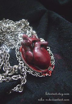 Anatomical Heart Necklace - It's the dripping blood that seals the deal for me