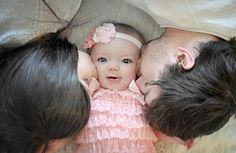 Baby girl's 6 month pictures with me her Mommy and her daddy! Love this one so much!/ family pictures