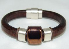 """SOLD. """"Licorice"""" style brown leather with bronze clay focal bead flanked by brushed metal rings & magnetic clasp"""