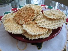 pizzelle cookies. Professor is taking in an Italian dish for cultural day at school. He wants to take Pizzelles!  AND Bratzelis which are a Swiss version of the pizzelle which I grew up with!