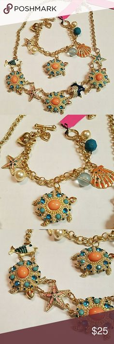 Absolutely gorgeous sea turtle necklace and bracel Absolutely gorgeous sea turtle starfish fish pearls charms Crystal and enamel necklace and bracelet set gold tone 18 inches long with a 2 inch extension. The bracelet is 7 inches long. Absolutely gorgeous Betsey Johnson Jewelry Necklaces