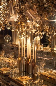 Metallic gold bottles as candle holders.