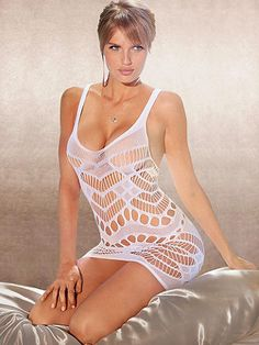 Seamless Patterned Chemise - A tantalizing mix of fishnet lace and cutout details highlights your body and your curves, revealing tempting flashes of skin. Features include: <ul>    <li>Allover fishnet and lace body in a geometric design</li>    <li>Alluring low neckline</li>    <li>Nylon/spandex</li>    <li>Imported</li> </ul> Our Essential Sheer Stockings will complete the look.