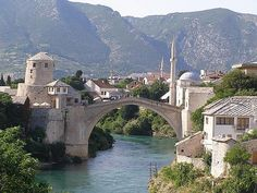 Old Mostar Bridge, Mostar, Bosnia & Hercegovina. UNESCO World Heritage Site. The historic town of Mostar, spanning a deep valley of the Neretva River, developed in the 15th & 16th century as an Ottoman frontier town. Mostar is known for its old Turkish houses and Old Bridge, Stari Most, after which it is named. In the 1990 war, much of the historic town and the Old Bridge, designed by the architect, Sinan, were destroyed. The old bridge & other bldgs have since been restored or rebuilt.